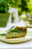 A slice of herb cake on a garden table