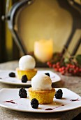 Mini saffron cakes served with vanilla ice cream and blackberries
