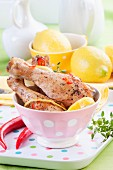 Baked chicken legs with lemon and chilli peppers