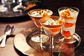 Mango trifle with pistachios in stemmed glasses