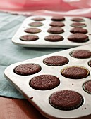 Chocolate cupcakes in a baking tin