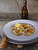 Pheasant soup with peas, carrots and potatoes