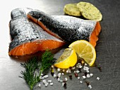 Salmon fillets with herb butter, lemon, dill, salt and pepper
