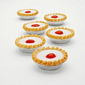 Cherry Bakewell tarts in foil cases