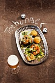 Minced meat cupcakes, cheese rolls and beer for a football-themed party