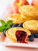 Mini peach and blueberry pies