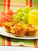 Scrambled egg and bacon tartlets