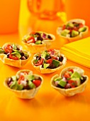 Pastry cups filled with avocado salsa