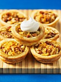 Nut tartlets with a dollop of cream