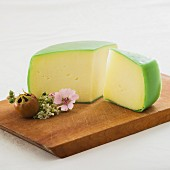 Organic cheese with a green rind