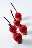 Marzipan cherries decorated with gold leaf