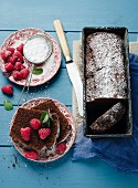 Chocolate cake with raspberries and icing sugar