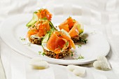 Salmon canapés on rye bread