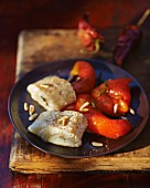 Cod fillets with marinated red peppers and pine nuts