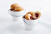 Mini doughnuts filled with strawberry jam
