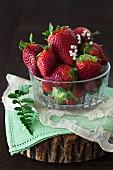 Fresh strawberries in a glass bowl