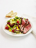Beefsteak with a colourful salad and bread
