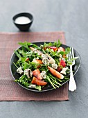 Rocket salad with strawberries, blue cheese and balsamic vinegar
