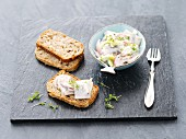 Herring salad with apple and radishes on homemade bread