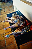 Legs of lamb on a barbecue