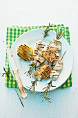 Grilled rabbit skewers with rosemary