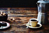 Espresso, biscuits and sugar cubes