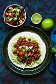 Chilli con carne with avocado served on tortilla (Mexico)