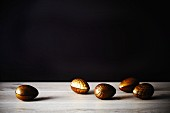 Golden chocolate Easter eggs on a wooden surface