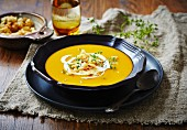 Pumpkin and carrot soup with creme fraiche