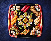 A sushi platter with nigiri and maki (seen from above)