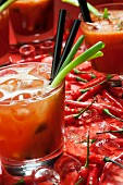 A Bloody Mary, fresh chilli peppers and ice cubes