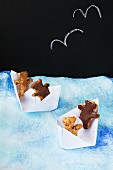 Teddy bear biscuits in paper boats