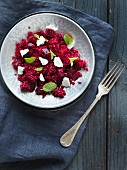 Couscous with beetroot, feta and mint leaves
