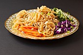 Pad Thai (noodle dish from Thailand) with carrots and red cabbage