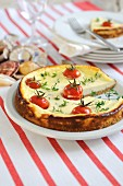 Savoury cream cheese tart with cherry tomatoes