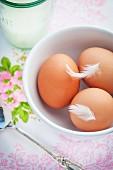 Three organic eggs and a glass of organic milk