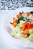 Spinach ricotta gnocchi with a tomato and spinach sauce