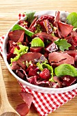 Mixed leaf salad with wild boar ham, beetroot and raspberries