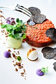 Beef tartar with quail's eggs and truffle slices