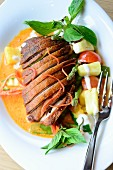 Duck breast with carrot sauce and pineapple (Asia)