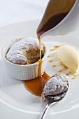 Christmas pudding souffle with caramel sauce and vanilla ice cream