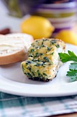 Fried cod fillet with parsley