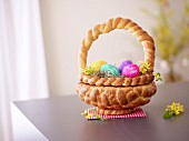 A Easter basket made of bread filled with Easter eggs