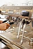 An espresso machine in an espresso bar