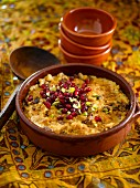 Rice pudding with pistachios and pomegranate seeds