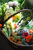 A basket of fresh organic vegetables and flowers