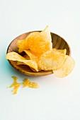 Potato crisps in a wooden bowl