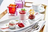 A platter of various desserts: strawberry cake, strawberry yogurt cream and chocolate ice cream