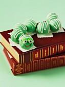 A cake pop bookworm