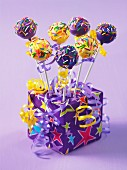 A birthday present decorated with colourful cake pops